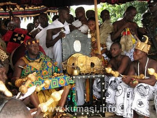 The Asantehene Otumfuo Osei II, sitting in state at Manhyia Dwaberem on 19/04/2009 during the celebration of the Adaekesee. On his left, seated on the Hwedom Chair, is the National Stool of Asanteman, i.e the Golden Stool.